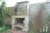 Stone fireplace/grill in courtyard