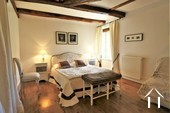 first floor bedroom with exposed beams