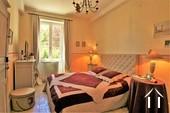 bedroom 1 behind private salon