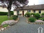 Gelijkvloerse bungalow met dubbele garage Ref # Li551 foto 1