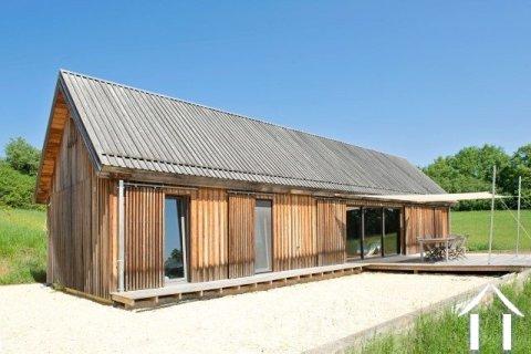 Houten huis met 5000 m² terrein en prachtig uitzicht Ref # MPLS1027