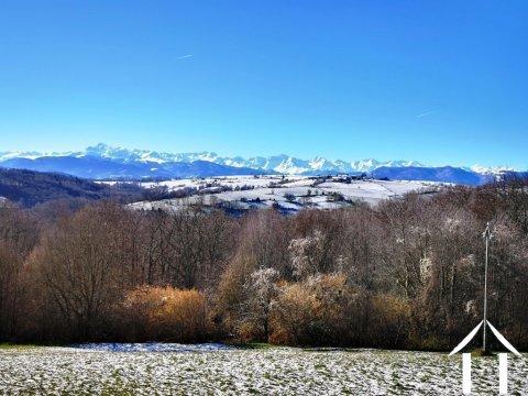 Gelijkvloers woonhuis met twee onafhankelijke woningen met tuin en en een adembenemend uitzicht op de Pyreneen. Ref # MPOA1830
