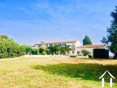 Ruime Franse boerderij (450m2) bestaande uit 2 aangrenzende huizen op 24.400m2 grond en verwarmd zwembad  Ref # MPOP0072 foto 1